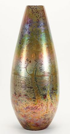 Clement Massier (French, 1844-1917) An iridescent glazed Vase which depicts a scene of Cannes, France
