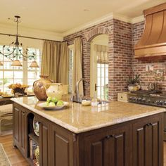 Spacious #Kitchen | The mix of warm colors and texture make this kitchen feel comfortable and cozy. The brick walls add architectural character to the space.