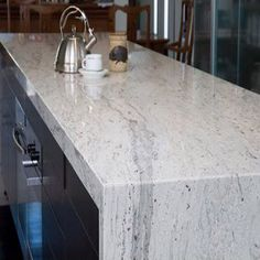 River White granite from India has low variations in its white and gray veining with small deep burgundy flecks. River white is a durable granite that is . Kitchen Island Granite Waterfall, Kitchen Island Bench, Small Kitchen Cabinets, Kitchen Paint, New Kitchen, Kitchen Ideas, Wood Cabinets, Kitchen Designs, Waterfall Counter