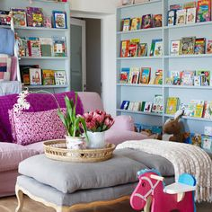 That book wall is a MUST for the boys playroom! Recreate using Ikea RIBBA wall picture ledges.