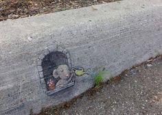 "A wonderful and inspiring picture or mural of a little mouse watering his/her garden on the curb.  Notice the cute little flower pot sitting on the window sill as well!  Can you say ""curb appeal""!"