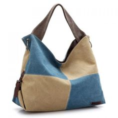 """Canvas Hobo Color Block Shoulder bag Two tone (Blueberry & Vanilla) canvas handbag. Detachable shoulder strap and two carrying handles. One 5"""" deep exterior zipper pocket. 2 interior zipper pockets and two media pockets. Fold bag with buckles at the bottom and unbuckle to expand. Folded 12"""" tall. Expanded 16"""" tall. 20"""" wide and 11"""" deep. Boutique Bags Hobos"""