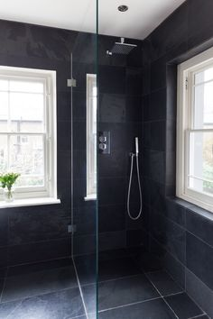 Slate shower room: I've always loved showers more than bathtubs, especially rain showers. Windows allow for natural light. Only thing I would add is a built-in nook for products and a teak bench/seat for shaving the legs!
