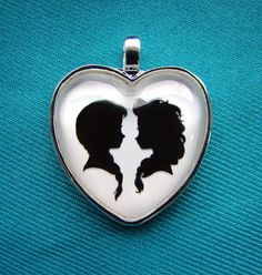Anna and Elsa Frozen Heart Silhouette Cameo Pendant by inknpaint