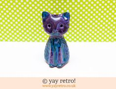 This is a gorgeous pottery cat which has turquoise and purple glazes.  She is really pretty and has been designed with a little hole in the top, so she...