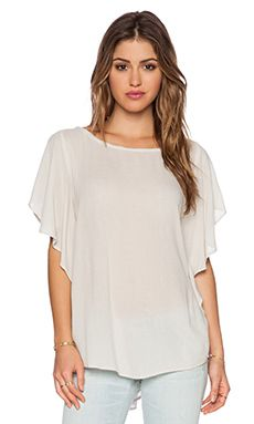 Shop for stunning Designer Tops for Women at REVOLVE CLOTHING. Find stylish Blouses, Button Downs, Tanks, Tees, Long & Short Sleeve tops & more from top brands! Long Shorts, Revolve Clothing, Summer Tops, Taupe, Stylish, Tees, Shopping, Collection, Women
