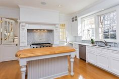 Traditional Kitchen with Glass panel, L-shaped, Custom hood, Inset cabinets, Complex marble counters, Flat panel cabinets