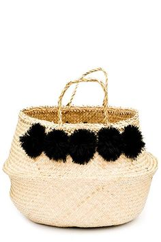 """""""If there's one design credo that rings true across style sets, it's that you can never have too many baskets — especially when they come festively festooned with pom-poms,"""" says Lack. """"Put one in your living room to hold throws, in your dining room for extra runners and cloth napkins, or in your bedroom for clutches or hats."""" #refinery29 http://www.refinery29.com/design-bloggers-cheap-decor-picks#slide-20"""