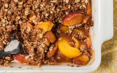 A simple peach crisp recipe made with fresh peaches and topped with a streusel made with oats, brown sugar, cinnamon, and butter.