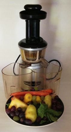 image of Omega VRT350S Juicer and a bowl of fruit and vegetables