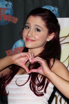 Ariana Grandes half-up, half-down hairstyle