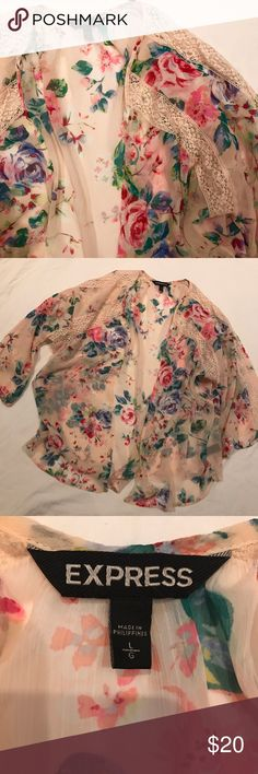 New Express Pastel Floral Print Lace Detail Kimono Absolutely gorgeous Express Kimono with cream Lace Detail and a beautiful pastel Floral pattern. Size large. Bundle for a discount, and don't be afraid to make a REASONABLE offer! :) I have very fair prices, keep that in mind Express Tops