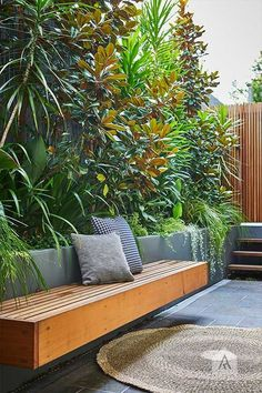 Love the wooden outdoor bench against dark gray slate floor!