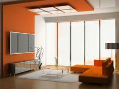 salon chic couleur de peinture pour salon mur orange tapis beige table en verre lampe de lecture