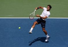 MASON, OH - AUGUST 19:  Roger Federer of Switzerland hits a volley against Novak Djokovic of Serbia during the final on day nine of the Western & Southern Open at Lindner Family Tennis Center on August 18, 2012 in Mason, Ohio.  (Photo by Nick Laham/Getty Images)