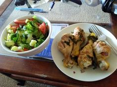 Deep fried chicken legs and salad