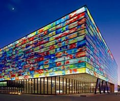The Institute for Sound and Vision in Hilversum, The Netherlands, has a massive media archive and museum. The facade features images from Dutch television, abstracted into a giant four-sided mural and baked directly onto cast glass.