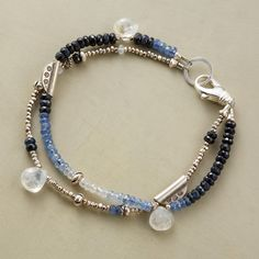"MOONLIGHT BLUES BRACELET -- A handmade moonstone and sapphire bracelet, in which moonstones shine out from a spectrum of blue sapphires mixed with sterling silver. A handcrafted exclusive with lobster clasp. Made in USA. 7-1/2""L."