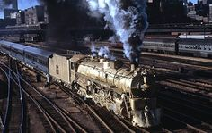 Gold-painted Chicago, Burlington & Quincy 4-8-4 No. 5632 passes Roosevelt Road in July 1964. The train commemorates the 100th anniversary of suburban service on the Burlington Route
