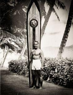 Duke Kahanamoku stands with a 116-pound redwood board, March 17, 1969 (Honolulu Star-Advertiser archive photo). Celebrating the 125th birthday of Duke Kahanamoku on August 24, 2015.