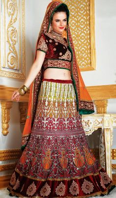 We unfurl our the intricacy and exclusivity of our creations highlighted in this lovely maroon, off white net & velvet chaniya choli. It has been beautifully designed with gold zardosi, lace, patch work, resham, sequins & stones work. This chaniya choli is famous for navratri occasion. #WeddingLehengaCholi