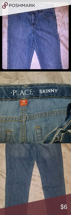 Boy's Children's place skinny leg jeans, size 10 Never worn boys skinny leg blue denim jeans, lighter blue **bundle with other boys jeans from my closet to save** Children's Place Bottoms Jeans