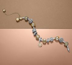 An autumn-inspired bracelet styling in sterling silver and 14k gold. The perfect accessory for fall. #PANDORA #PANDORAbracelet