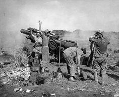Shelling Iwo, Iwo Jima, 1945  Photo caption: Iwo Jima, February 24, 1945. Shelling Iwo: Section chief, Marine Private First Class R. F. Callahan calls for fire and another 155 mm shell is hurled into a Japanese position.