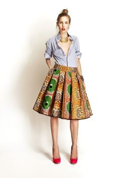 Full African print skirt worn with masculine striped shirt adds a contemporary twist to this look by Stella Jean.