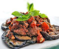 Crumbled organic beef with eggplant, tomatoes and fresh mint