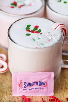 Peppermint Nog Punch - Celebrate the holiday season with Peppermint Nog Punch.  Eggless, homemade spiced nog with peppermint ice cream and candy canes.  Add a splash of rum to make this an adult drink.  Lightened up with @sweetnlowbrand. #DontHesitaste #spon
