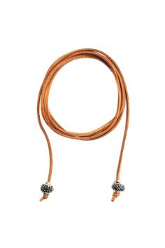"""This suede wrap around choker necklace is available in two fabulous colors (black and brown) to complement every look. This necklace can be worn as a short choker longer necklace triple-wrap bracelet wrap anklet and a Bohemian-style headband or hairband. This necklace is also highly resistant to tarnishing for easy wear and care.  Necklace measures approximately 64"""".  Suede Rhinestone Choker by Lets Accessorize. Accessories - Jewelry - Necklaces - Chokers New York"""