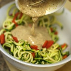Quick Noodle Bowl serves 1 Ingredients: 3 medium zucchini, spiralized 1/2 batch creamy Asian dressing Veggies of choice (shredded carrots, bell peppers, scallions, etc.)