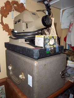 Vendor 4949 has a really cool slide projector and with it's original box to come with it!