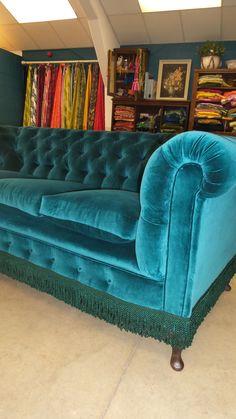 Sumptuous peacock velvet Chesterfield detailed with emerald bullion fringing .Designed by Velvet Eccentric Interiors.