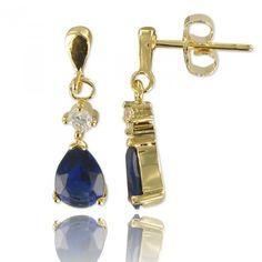 Boucles d'oreilles plaqué or ornée d'une en oxyde de zirconium bleu en forme de goutte.  Gold-plated earrings decorated with one in oxide of zirconium blue in the shape of drop.