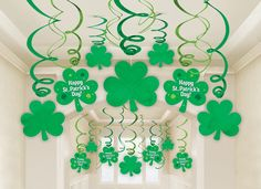 """Fashion your house with these fun shamrock and swirl danglers for an instant party! Patrick's Day Mega Swirl Value Pack includes green foil swirls, foil shamrocks, and paper shamrock cut-outs complete with a """"Happy St. Deco St Patrick, Sant Patrick, St Patrick's Day Crafts, Holiday Crafts, Crafts For Kids, Holiday Fun, Image St Patrick, Saint Patrick's Day, St Patrick's Day Decorations"""