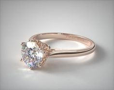 The basket of this design is reminiscent of flowers making their first appearance in the early, warm months, rendering it the perfect style for a romance that blossomed in spring or a proposal planned during those months. | Ring Style 17313R14 on JamesAllen.com. Click to view this ring in 360° HD.