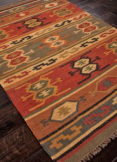 The Bedouin collection is hand woven in wool and jute. It has a rustic, authentic look inspired by traditional kilimm patterns in rich rusts, blues and golds. The collection has a vintage, eclectic lo