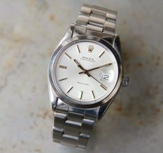 """This is a Rolex oysterdate from 1979. White dial Ref. 6694. Manual movement. The high-grade calibre 1225 movement is complete with 17 rubies. 34mm diameter. Brushed and polished case with plain bezel, screw down Rolex oyster crown and screw on back. 8"""" Rolex Oyster bracelet ref.78350. The piece is in original condition and keeps very good time. We have fully serviced and regulated the movement."""