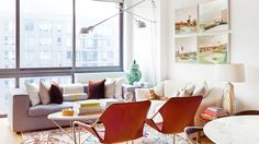 Inspiring Decorating Ideas For Rentals // living room, leather sling chair, swing wall light