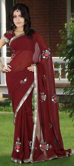 77028:Red and Maroon color family Saree with matching unstitched blouse.