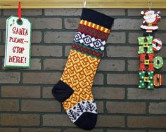 This incredible knit Christmas stocking will look great on your fireplace mantle this holiday! I hand knit this stocking which features Yellow hearts on the leg and dark Purple trees near the toe. The cuff, heel and toe are in Navy Blue . Anyone would be excited to look for Christmas morning goodies in this lovely stocking!  FREE Personalization!! Your stocking can be personalized on the cuff. For best results 6 - 7 letter names work best. Please leave me a note when you make your purchase…