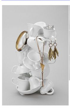 diy teacup jewelry stand    I like this idea, but the white seems to lack texture. Something colorful/printed would be fun