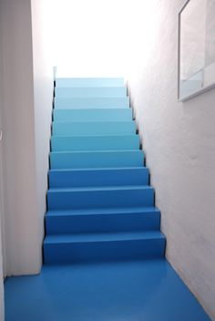 There is just something a out these stairs...perhaps the white walls and wonderful illumination for the top of them.  Blue staircase