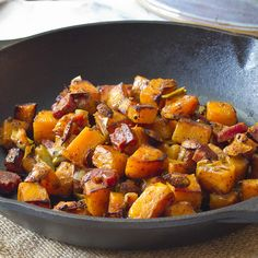 For a seasonal dish with global flair, prepare butternut squash with fragrant red curry powder, creamy coconut milk and savory pancetta. Reserve squash seeds and toast them to enhance the dish with a nutty crunch. Photo credit: Sommer Collier from A Spicy Perspective.