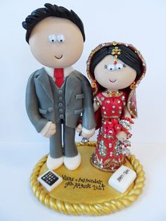 Asian Bride & Groom wedding cake topper. Handmade & totally personalised to look like the couple. Any outfits/poses are possible, something like this would be £149.99 for the couple, £9.99 for a base (they don't need on to stand up). NOT EDIBLE, I send my work anywhere in the World. I can add little props, like here, an Ipad & a shoe box, to show the couple's interests! #indianwedding #pakistaniwedding #weddings