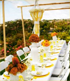 Love, love, love the table setting, the DIY chandelier, the flowers, and the amazing canopy!