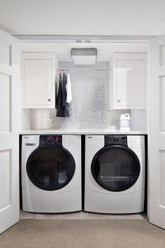 In this small laundry closet, not an inch of space is wasted. A countertop unites side-by-side units and forms a surface for folding clothes and stashing hampers. A hanging rod is fastened above to air dry delicates, while a splash of silver tile brightens even the most mundane chore.