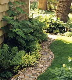 I love this rock border idea....great idea to reuse stone mulch that I want to remove from the front landscaping